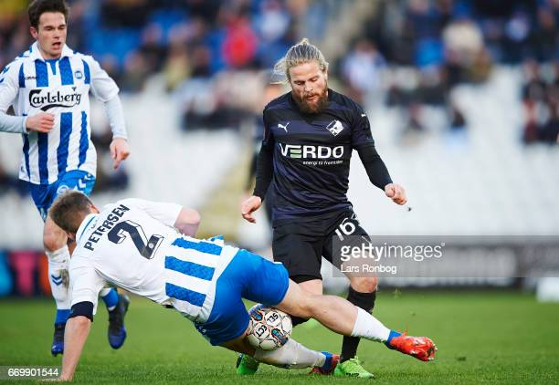 Kasper Fisker of Randers FC and Kenneth Emil Petersen of OB Odense compete for the ball during the Danish Alka Superliga match between OB Odense and...