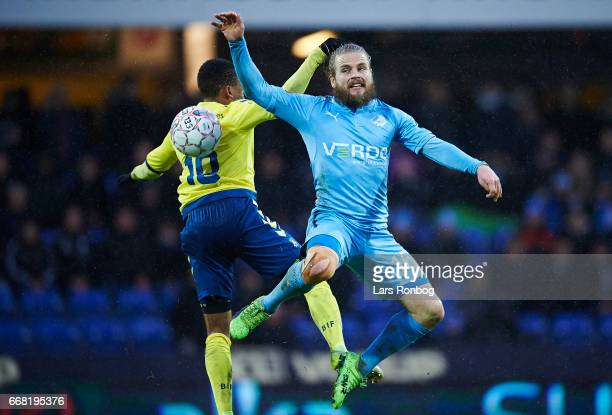 Kasper Fisker of Randers FC and Lebogang Phiri of Brondby IF compete for the ball during the Danish Cup DBU Pokalen quarterfinal match between...