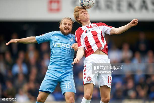 Kasper Fisker of Randers FC and Magnus Christensen of AaB Aalborg compete for the ball during the Danish Alka Superliga match between Randers FC and...