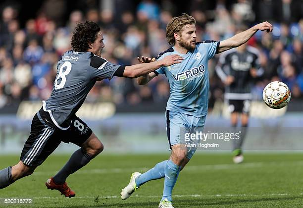 Kasper Fisker of Randers FC and Thomas Delaney compete for the ball during the Danish Alka Superliga match between Randers FC and FC Copenhagen at...