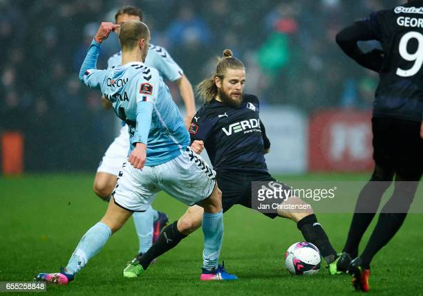 Kasper Fisker of Randers FC compete for the ball during the Danish Alka Superliga match between SonderjyskE and Randers FC at Sydbank Park on March...