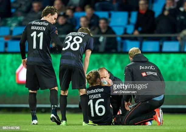 Kasper Fisker of Randers FC get an injury during the Danish Alka Superliga match between AaB Aalborg and Randers FC at Aalborg Portland Park on May...