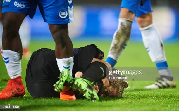 Kasper Fisker of Randers FC injured on the pitch during the Danish Alka Superliga match between OB Odense and Randers FC at EWII Park on February 20...