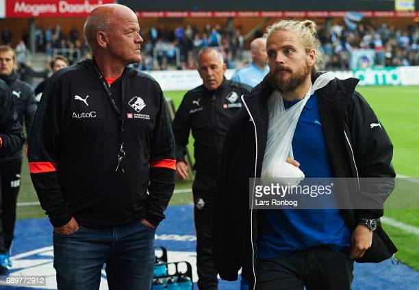 Kasper Fisker of Randers FC with a broken hand leaving the bench during halftime in the Danish Alka Superliga match between Randers FC and OB Odense...