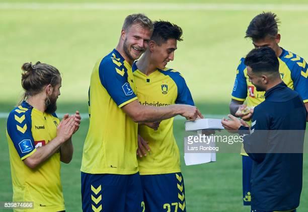 Kasper Fisker Paulus Arajuuri and Svenn Crone of Brondby IF celebrate after the Danish Alka Superliga match between Brondby IF and AC Horsens at...