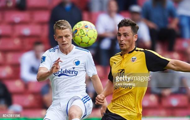 Kasper Kusk of FC Copenhagen and Vito HammershojMistrati of Hobro IK compete for the ball during the Danish Alka Superliga match between FC...