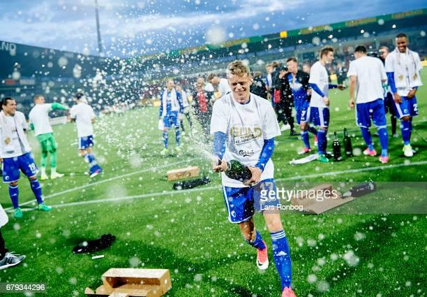 Kasper Kusk of FC Copenhagen celebrates with champagne as danish champions after the Danish Alka Superliga match between FC Nordsjalland and FC...