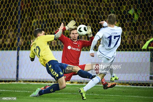 Kasper Kusk of FC Copenhagen in action against Goalkeeper Frederik Ronnow of Brondby IF and Daniel Agger of Brondby IF during the Danish Alka...