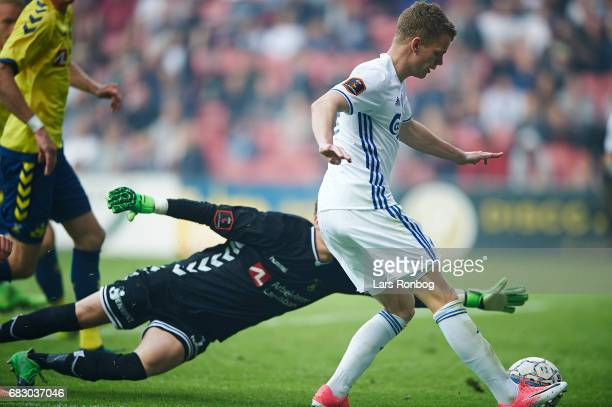 Kasper Kusk of FC Copenhagen in action against Goalkeeper Frederik Ronnow of Brondby IF during the Danish Alka Superliga match between FC Copenhagen...