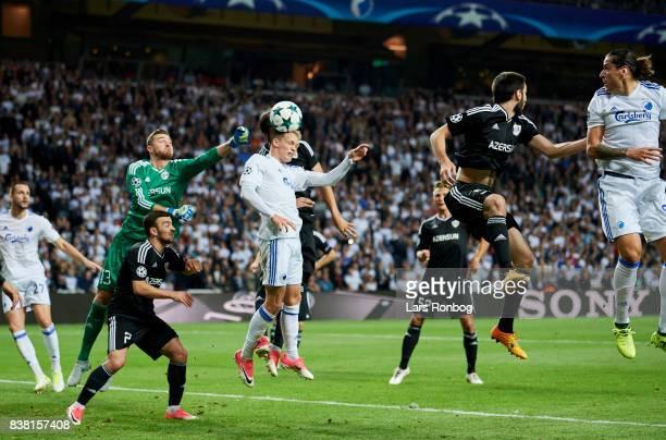Kasper Kusk of FC Copenhagen in action against Goalkeeper Ibrahim Sehic of Qarabag FK during the UEFA Champions League Playoff 2nd Leg match between...