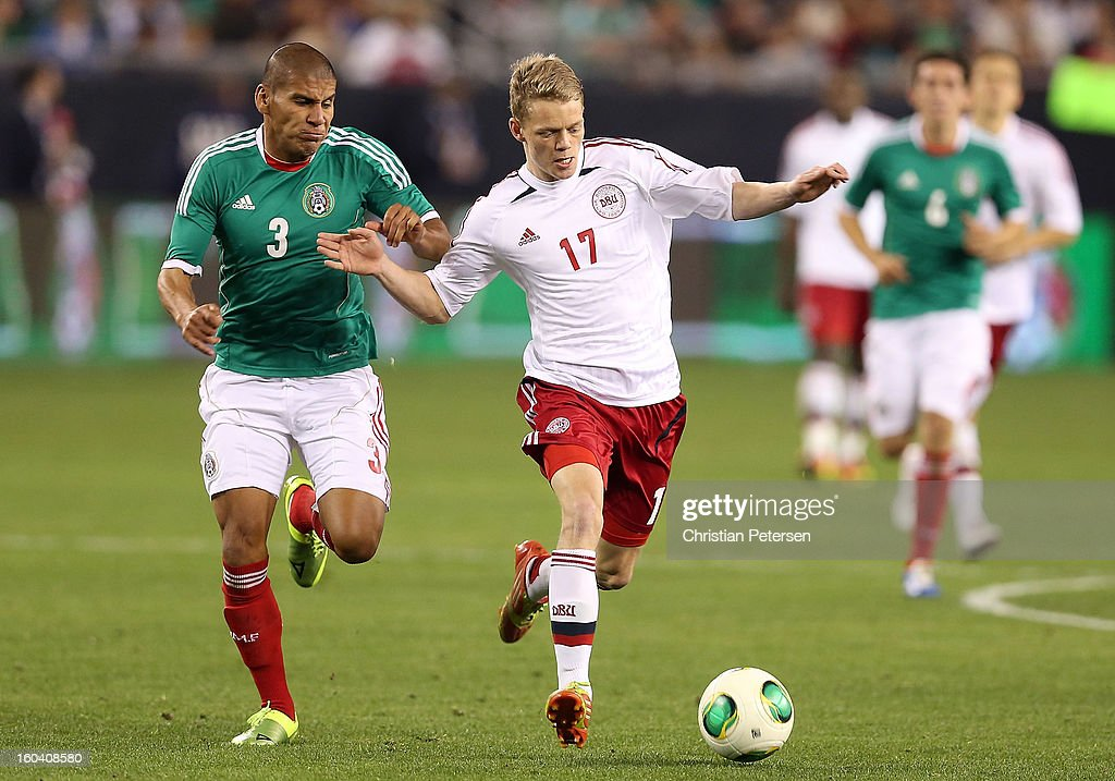 Kasper Larsen #17 of Denmark controls the ball past <a gi-track='captionPersonalityLinkClicked' href=/galleries/search?phrase=Carlos+Salcido&family=editorial&specificpeople=241267 ng-click='$event.stopPropagation()'>Carlos Salcido</a> #3 of Mexico during the second half of an international friendly match at University of Phoenix Stadium on January 30, 2013 in Glendale, Arizona. Mexico and Denmark ended in a 1-1 draw.