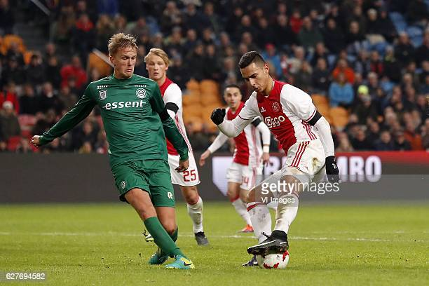 Kasper Larsen of FC Groningen Kasper Dolberg of Ajax Abdelhak Nouri of Ajax Anwar El Ghazi of Ajaxduring the Dutch Eredivisie match between Ajax...