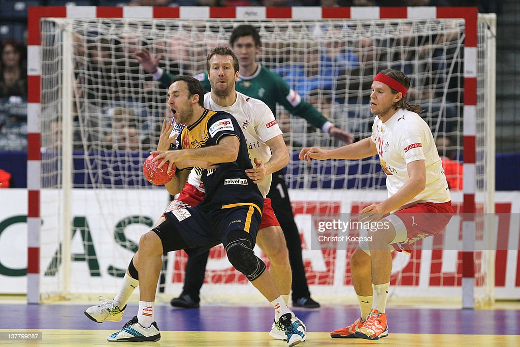 <a gi-track='captionPersonalityLinkClicked' href=/galleries/search?phrase=Kasper+Nielsen&family=editorial&specificpeople=663024 ng-click='$event.stopPropagation()'>Kasper Nielsen</a> of Denmark (2nd L) defends against Roberto Garcia of Spain (L) during the Men's European Handball Championship first semi final match between Denmark and Spain at Beogradska Arena on January 27, 2012 in Belgrade, Serbia.