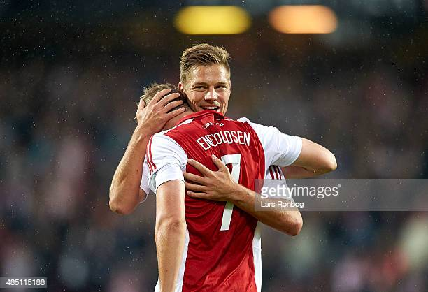 Kasper Risgard of AaB Aalborg and goalscorer Thomas Enevoldsen celebrates after scoring their first goal during the Danish Alka Superliga match...