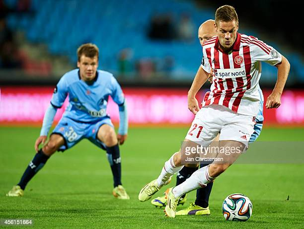 Kasper Risgard of AaB Aalborg controls the ball during the Danish Superliga match between AaB Aalborg and Randers FC at Nordjyske Arena on September...