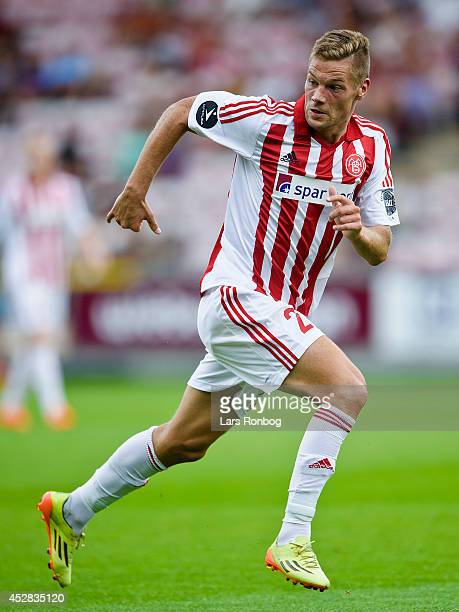 Kasper Risgard of AaB Aalborg in action during the Danish Superliga match between AaB Aalborg and FC Midtjylland at Nordjyske Arena on July 26 2014...