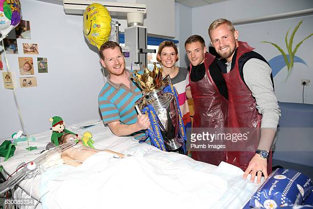 Kasper Schmeichel and Jamie Vardy with a sleeping patient and his family as they deliver Christmas presents to patients at Leicester Royal Infirmary...