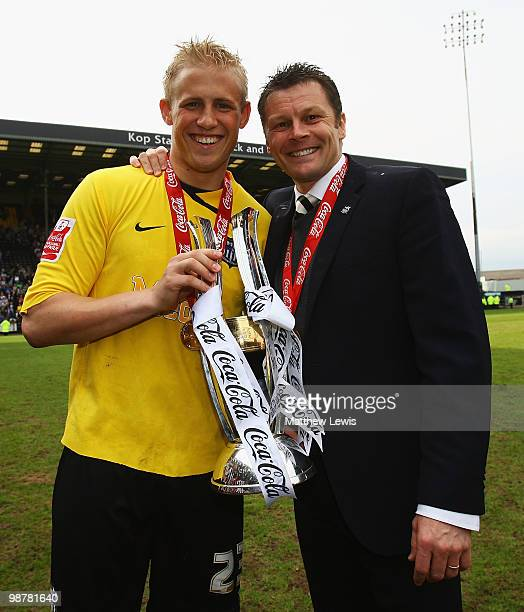 Kasper Schmeichel and Steve Cotterill manager of Notts County celebrate winning the CocaCola League Two Championship after the CocaCola League Two...