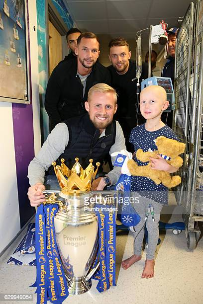 Kasper Schmeichel Danny Drinkwater and Ben Hamer during the Leicester City Players Deliver Christmas Presents to Patients at Leicester Royal...
