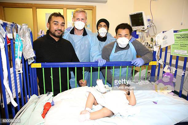 Kasper Schmeichel Danny Simpson and Shinji Okazaki during the Leicester City players deliver Christmas presents to patients at Leicester Royal...