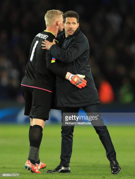 Kasper Schmeichel of Leicester City and Diego Simeone Manager of Atletico Madrid embrace after the UEFA Champions League Quarter Final second leg...