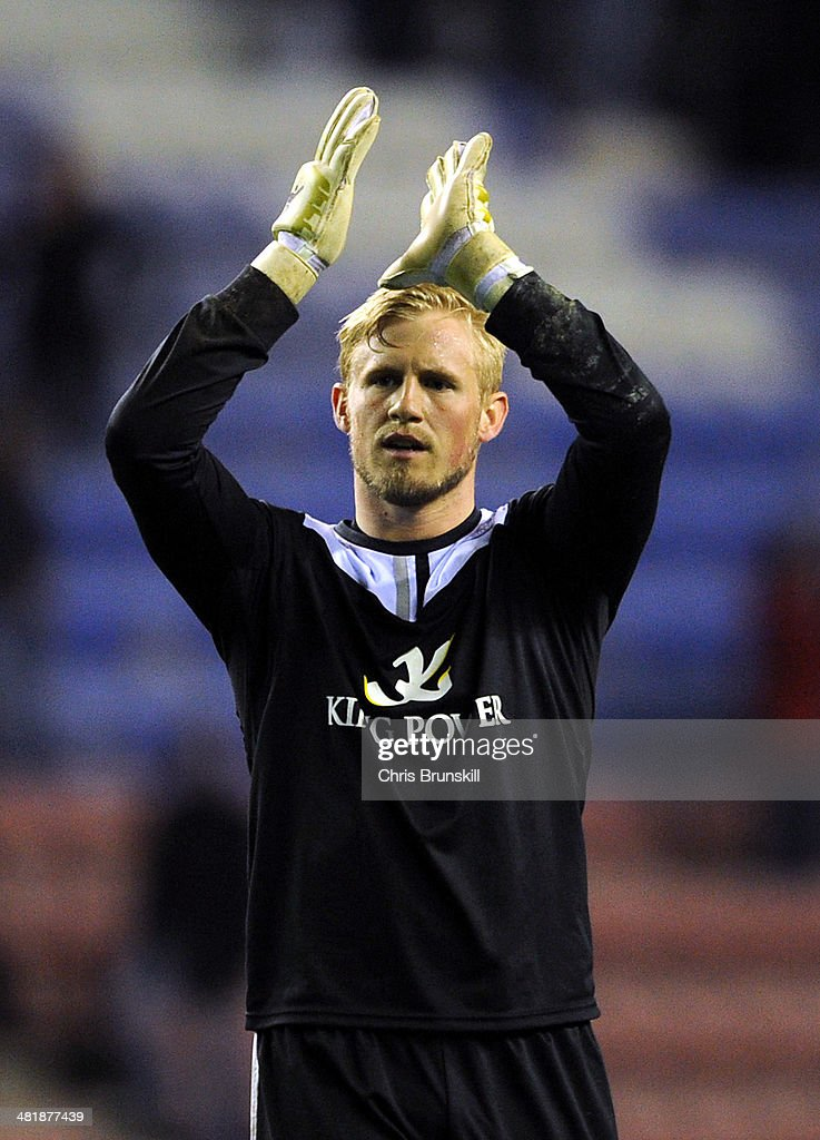 <a gi-track='captionPersonalityLinkClicked' href=/galleries/search?phrase=Kasper+Schmeichel&family=editorial&specificpeople=2309352 ng-click='$event.stopPropagation()'>Kasper Schmeichel</a> of Leicester City applauds the supporters at full-time following the Sky Bet Championship match between Wigan Athletic and Leicester City at DW Stadium on April 01, 2014 in Wigan, England.