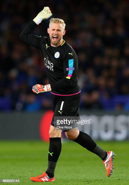Kasper Schmeichel of Leicester City celebrates after Jamie Vardy of Leicester City scored Leicester City's first goal during the UEFA Champions...
