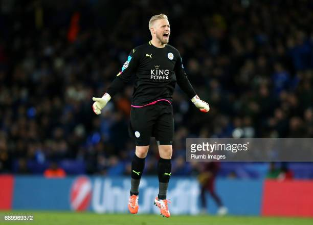 Kasper Schmeichel of Leicester City celebrates after Jamie Vardy of Leicester City scores to make it 11 during the UEFA Champions League Quarter...