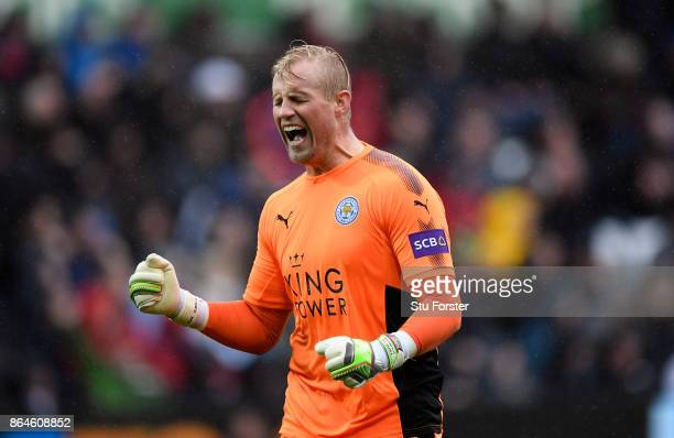 Kasper Schmeichel of Leicester City celebrates after Leicester City scored there first goal during the Premier League match between Swansea City and...