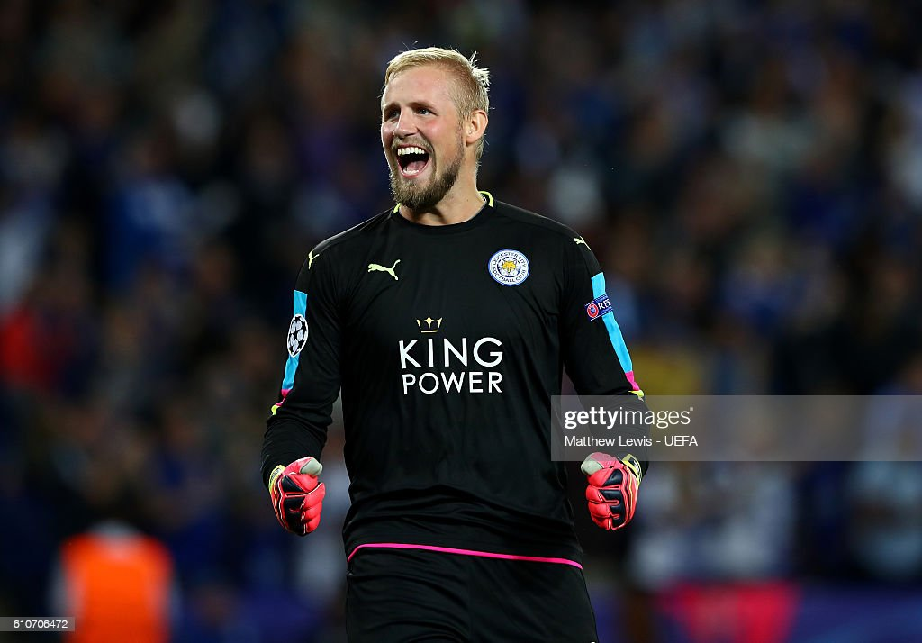 Kasper Schmeichel of Leicester City celebrates as Islam Slimani of Leicester City scores their first goal during the UEFA Champions League Group G match between Leicester City FC and FC Porto at The King Power Stadium on September 27, 2016 in Leicester, England.