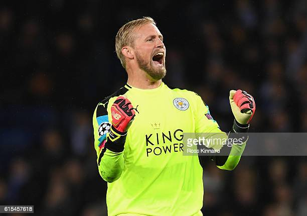 Kasper Schmeichel of Leicester City celebrates his team's win at the final whitsle during the UEFA Champions League Group G match between Leicester...