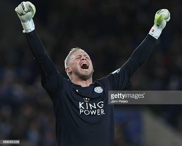 Kasper Schmeichel of Leicester City celebrates Jamie Vardy scoring their first goal during the Barclays Premier League match between Leicester City...