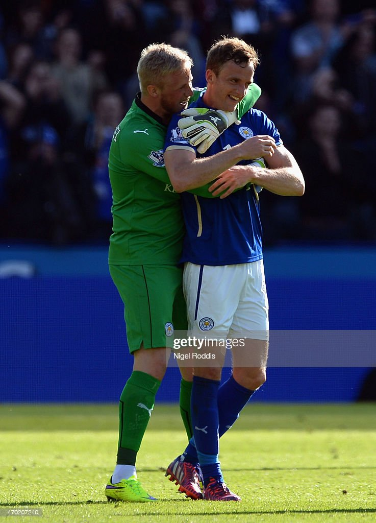 Kasper Schmeichel of Leicester City celebrates with Andy King of Leicester City during the Barclays Premier League match between Leicester City and Swansea City at The King Power Stadium on April 18, 2015 in Leicester, England.