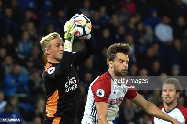 Kasper Schmeichel of Leicester City collects a cross under pressure during the Premier League match between Leicester City and West Bromwich Albion...