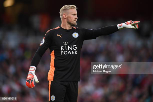 Kasper Schmeichel of Leicester City directs his defence during the Premier League match between Arsenal and Leicester City at the Emirates Stadium on...