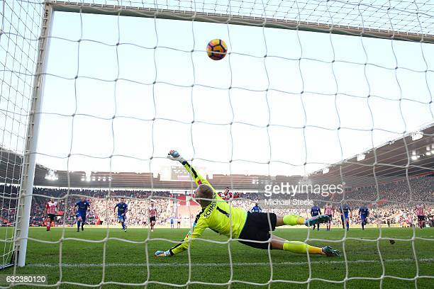 Kasper Schmeichel of Leicester City dives in vain as Dusan Tadic of Southampton converts the penalty to score his team's third goal during the...