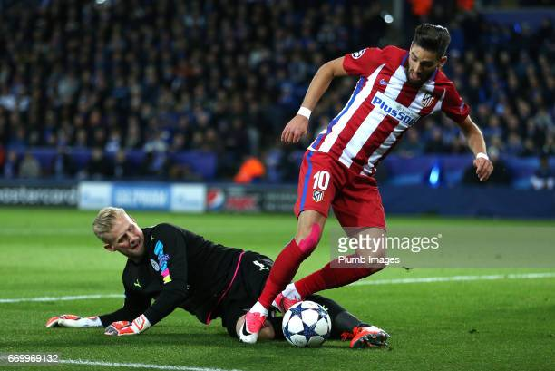 Kasper Schmeichel of Leicester City in action with Yannick Carrasco of Atletico Madrid during the UEFA Champions League Quarter Final Second Leg...