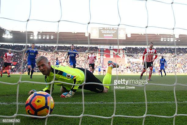 Kasper Schmeichel of Leicester City reacts as Dusan Tadic of Southampton converts the penalty to score his team's third goal during the Premier...