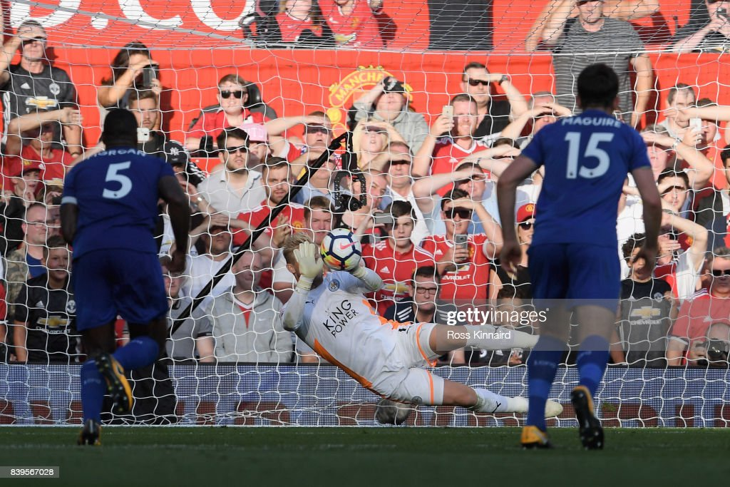 Kasper Schmeichel of Leicester City saves Romelu Lukaku of Manchester United (not pictured) penalty during the Premier League match between Manchester United and Leicester City at Old Trafford on August 26, 2017 in Manchester, England.