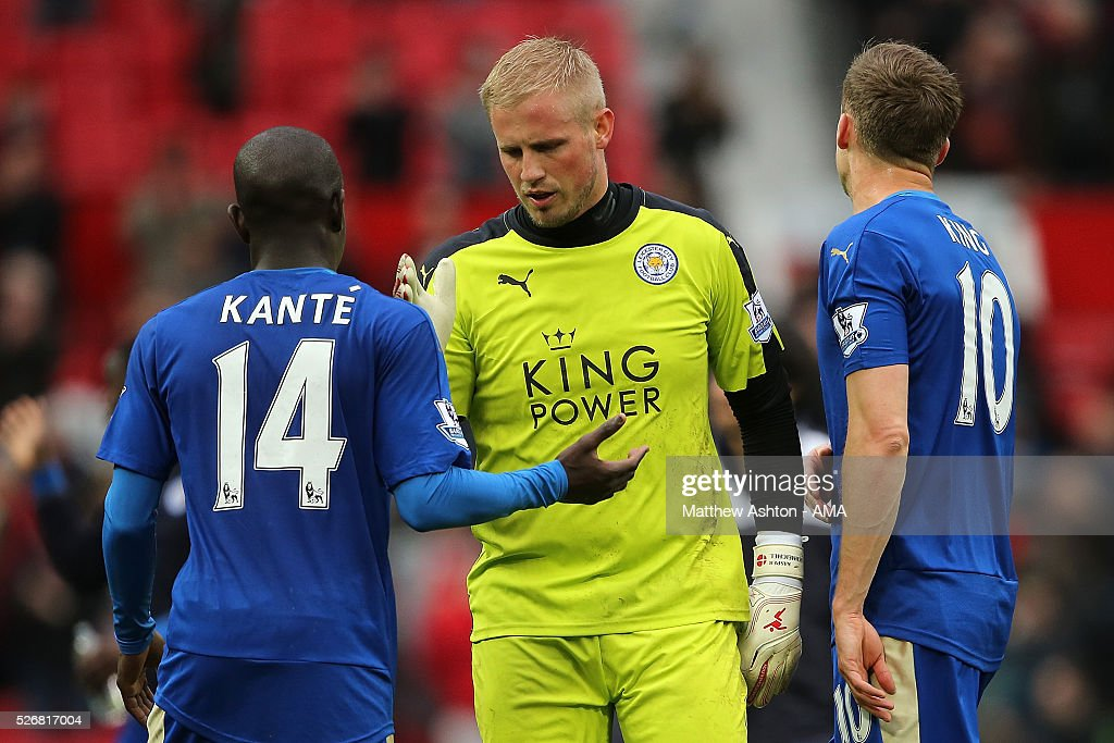 <a gi-track='captionPersonalityLinkClicked' href=/galleries/search?phrase=Kasper+Schmeichel&family=editorial&specificpeople=2309352 ng-click='$event.stopPropagation()'>Kasper Schmeichel</a> of Leicester City shakes hands with N'Golo Kante at the end of the Barclays Premier League match between Manchester United and Leicester City at Old Trafford on May 1, 2016 in Manchester, United Kingdom.