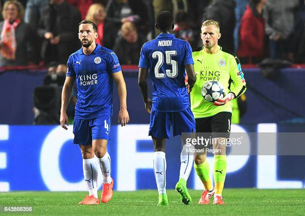 Kasper Schmeichel of Leicester City speaks with teammate Wilfred Ndidi during the UEFA Champions League Round of 16 first leg match between Sevilla...