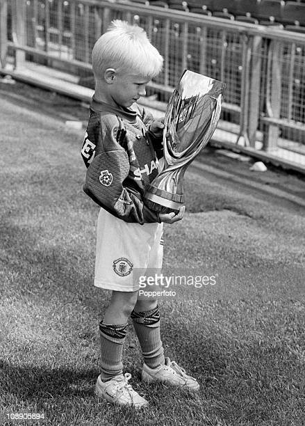 Kasper Schmeichel son of Manchester United goalkeeper Peter Schmeichel holding the UEFA Super Cup at Old Trafford Manchester in August 1992