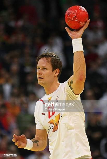 Kasper Soendergaard Sarup of Denmark passes the ball during the Men's European Handball Championship final match between Serbia and Denmark at...