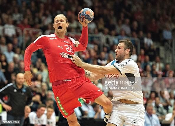 Kasper Sondergaard of Denmark and Vytautas Ziura of Austria vie during their men's World Championship handball qualification match between Denmark...