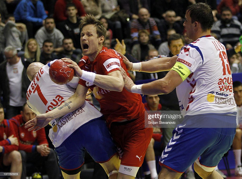 Kasper Sondergaard Sarup (C) of Denmark competes with Ivan Nikcevic (R) and <a gi-track='captionPersonalityLinkClicked' href=/galleries/search?phrase=Momir+Ilic&family=editorial&specificpeople=857763 ng-click='$event.stopPropagation()'>Momir Ilic</a> of Serbia during the Men's European Handball Championship 2012 group A match between Serbia and Denmark at Pionir Arena on January 17, 2011 in Belgrade, Serbia.