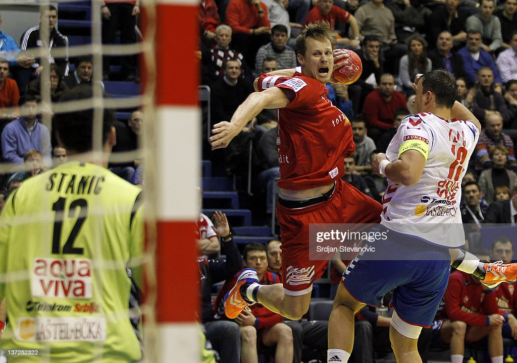 Kasper Sondergaard Sarup (C) of Denmark competes with <a gi-track='captionPersonalityLinkClicked' href=/galleries/search?phrase=Momir+Ilic&family=editorial&specificpeople=857763 ng-click='$event.stopPropagation()'>Momir Ilic</a> (R) from Serbia during the Men's European Handball Championship 2012 group A match between Serbia and Denmark at Pionir Arena on January 17, 2011 in Belgrade, Serbia.