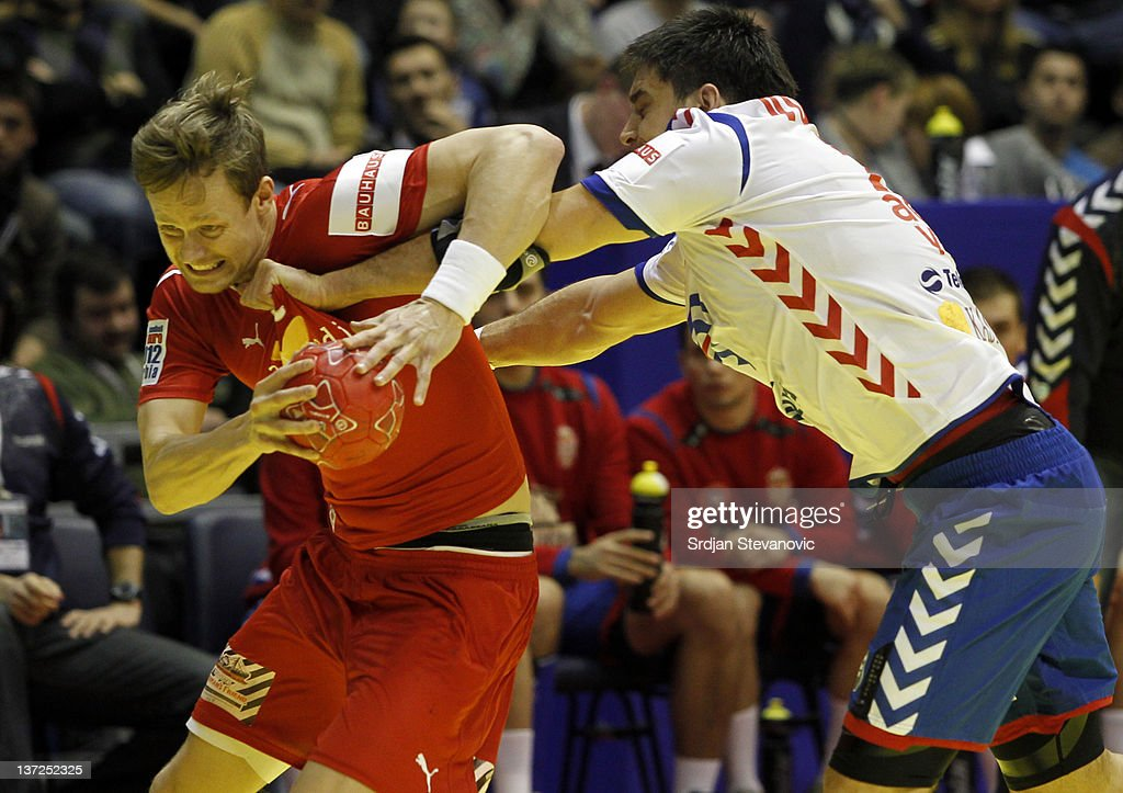Kasper Sondergaard Sarup (L) of Denmark competes with Vuckovic Nenad (R) of Serbia during the Men's European Handball Championship 2012 group A match between Serbia and Denmark at Pionir Arena on January 17, 2011 in Belgrade, Serbia.