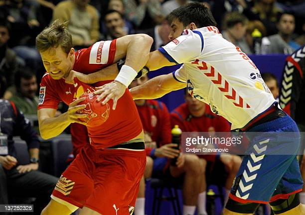 Kasper Sondergaard Sarup of Denmark competes with Vuckovic Nenad of Serbia during the Men's European Handball Championship 2012 group A match between...