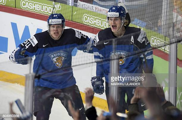 Kasperi Kapanen and Roope Hintz of Finland celebrate after Hintz scored 11 during the 2016 IIHF World Junior Ice Hockey Championship semifinal match...