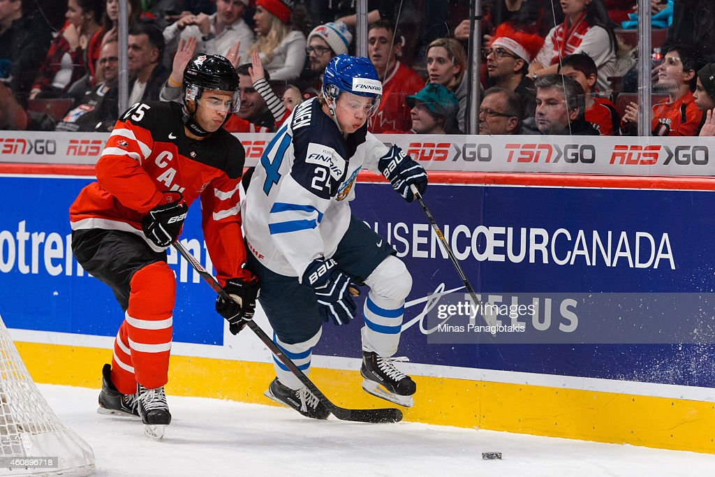 <a gi-track='captionPersonalityLinkClicked' href=/galleries/search?phrase=Kasperi+Kapanen&family=editorial&specificpeople=8807180 ng-click='$event.stopPropagation()'>Kasperi Kapanen</a> #24 of Team Finland goes after the puck with <a gi-track='captionPersonalityLinkClicked' href=/galleries/search?phrase=Darnell+Nurse&family=editorial&specificpeople=9156575 ng-click='$event.stopPropagation()'>Darnell Nurse</a> #25 of Team Canada following close behind during the 2015 IIHF World Junior Hockey Championship game at the Bell Centre on December 29, 2014 in Montreal, Quebec, Canada.